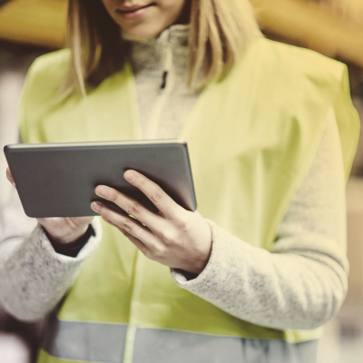 Lady in high-vis holding an iPad