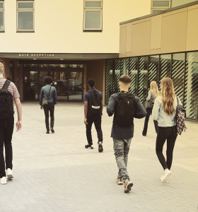 Students entering a school building